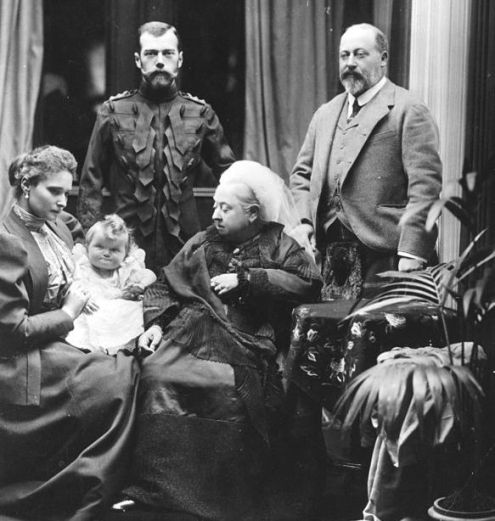 Victoria, Queen of the United Kingdom, at Balmoral Castle in Scotland, with her son Albert Edward, Prince of Wales (right), and Tsar Nicholas II of Russia (left). Seated on the left is Alexandra, Tsarina of Russia, holding her baby daughter Grand Duchess Olga.